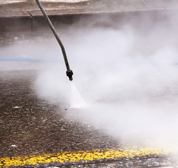 Drive-Thru Pressure Washing by Evergreen Law Care in Gainesville, FL